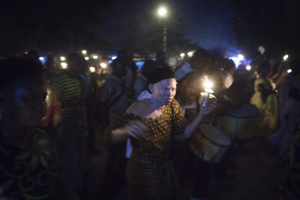 Worshippers carry oil lanterns during a night time procession through the streets of Benin's main city of Cotonou,